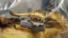 Egypt displays restoration of Tutankhamun gilded coffin