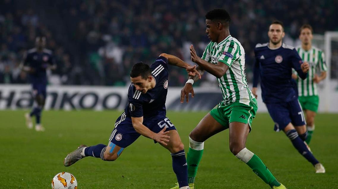 Betis' Junior Firpo (R) during the Europa League Group F soccer match between Betis and Olympiakos at the Benito Villamarin Stadium in Seville, Spain. (File photo: AP)