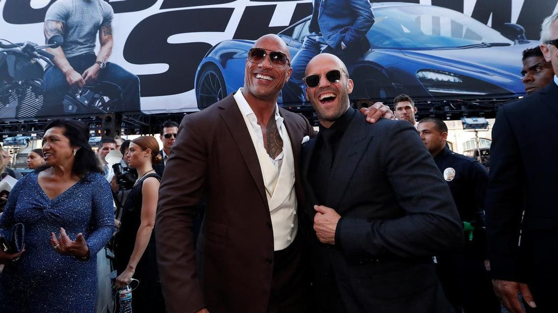 """Cast members Dwayne Johnson and Jason Statham arrive at the premiere for """"Fast & Furious Presents: Hobbs & Shaw"""" in Los Angeles. (Reuters)"""