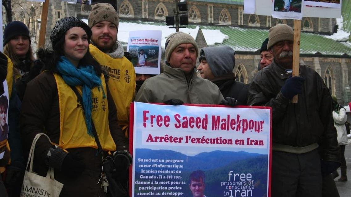 This January 22, 2012 photo shows supporters demonstrating for the release of Saeed Malekpour, in Phillips Square in Montreal, Quebec, Canada. AFP