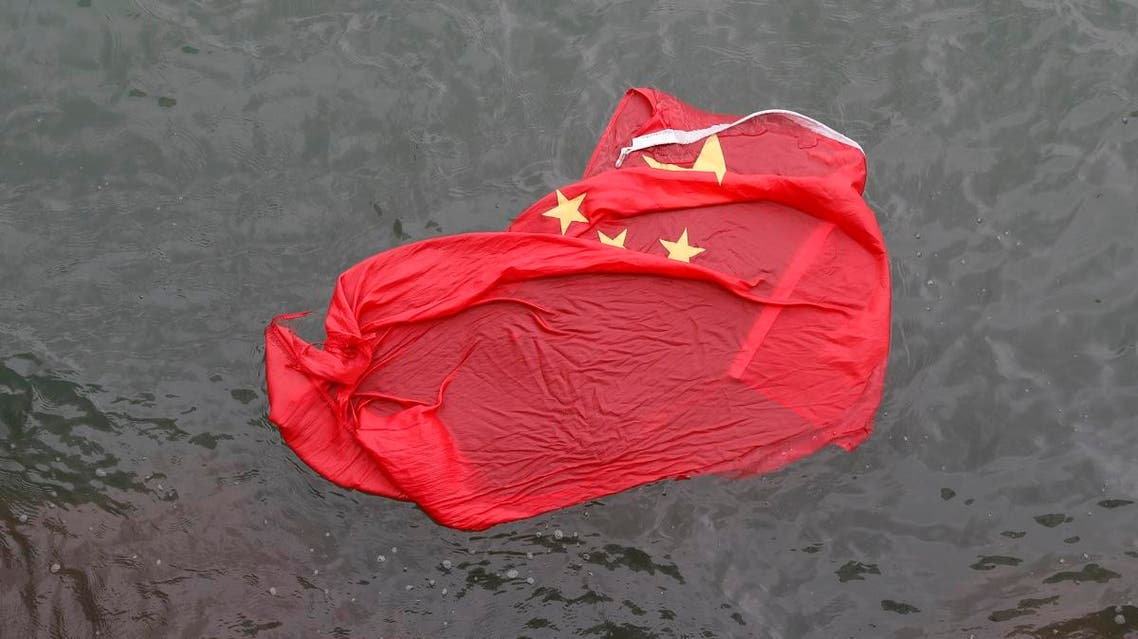 A Chinese flag floats on the surface it was thrown in the water by protesters during a demonstration in Hong Kong, Saturday, Aug. 3, 2019. (AP)