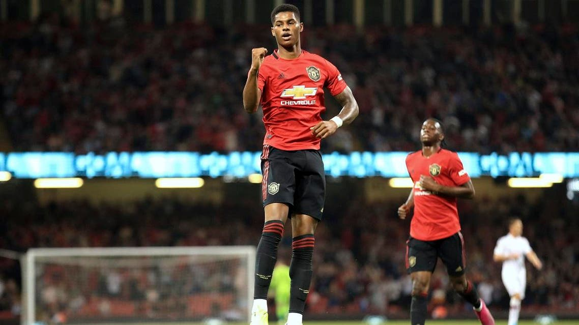 Manchester United's Marcus Rashford celebrates scoring his side's first goal of the game during the Pre-Season match between Manchester United and AC Milan. (AP)