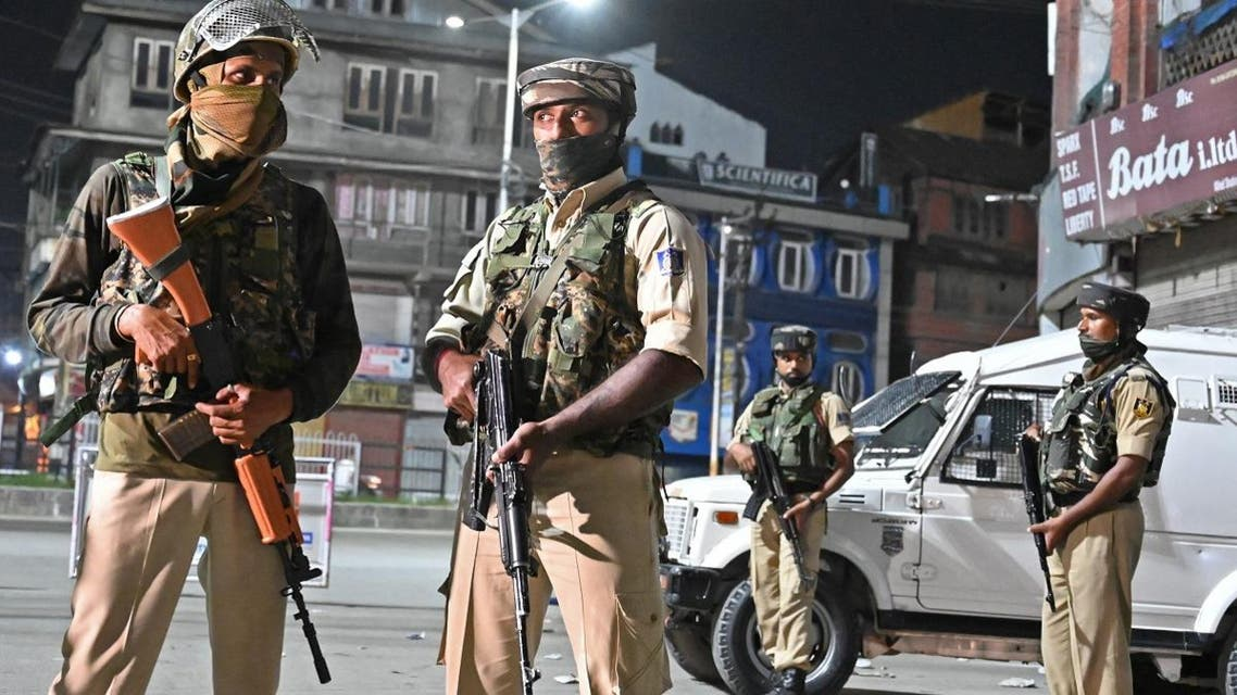 Indian paramilitary troopers stand guard at a roadblock at Maisuma locality in Srinagar on August 4, 2019. (AFP)