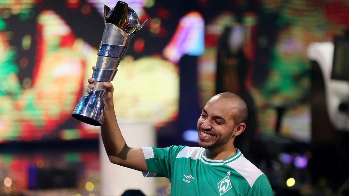 Mo Harkous (MoAuba) of Germany celebrates with the trophy after winning the FIFA eWorld Cup at O2 Arena, London, Britain, on August 4, 2019. (Reuters)