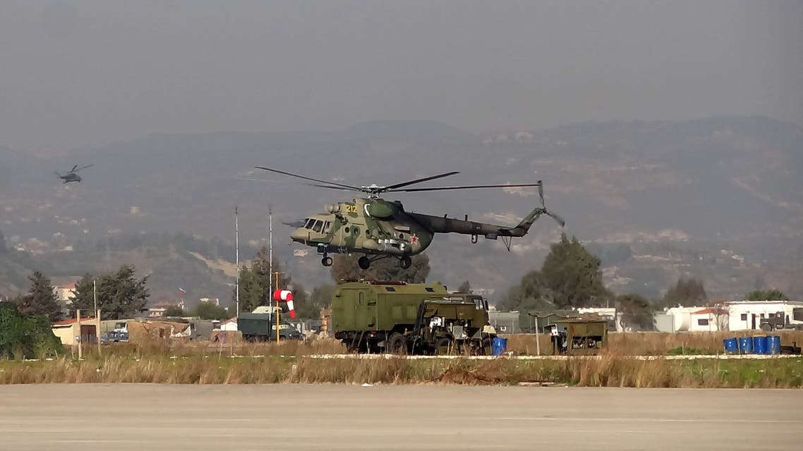 A military helicopter is seen at the Russian Hmeimim military base in Latakia province, in the northwest of Syria, on February 16, 2016.
