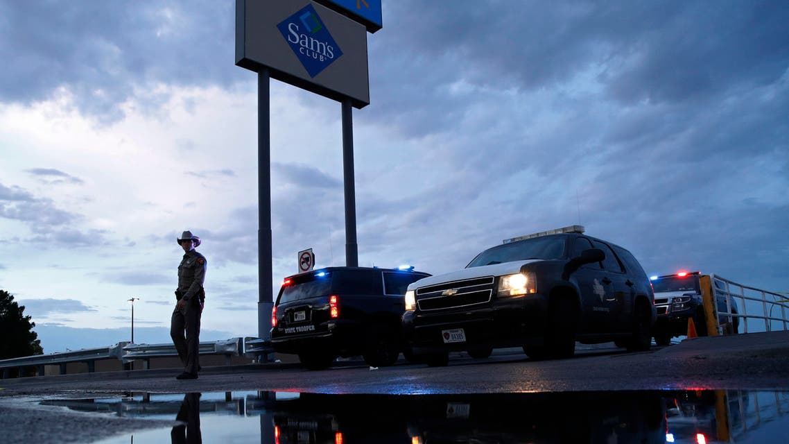 Law enforcement officials block a road at the scene of a mass shooting at a shopping complex Sunday, Aug. 4, 2019, in El Paso, Texas. (AP)