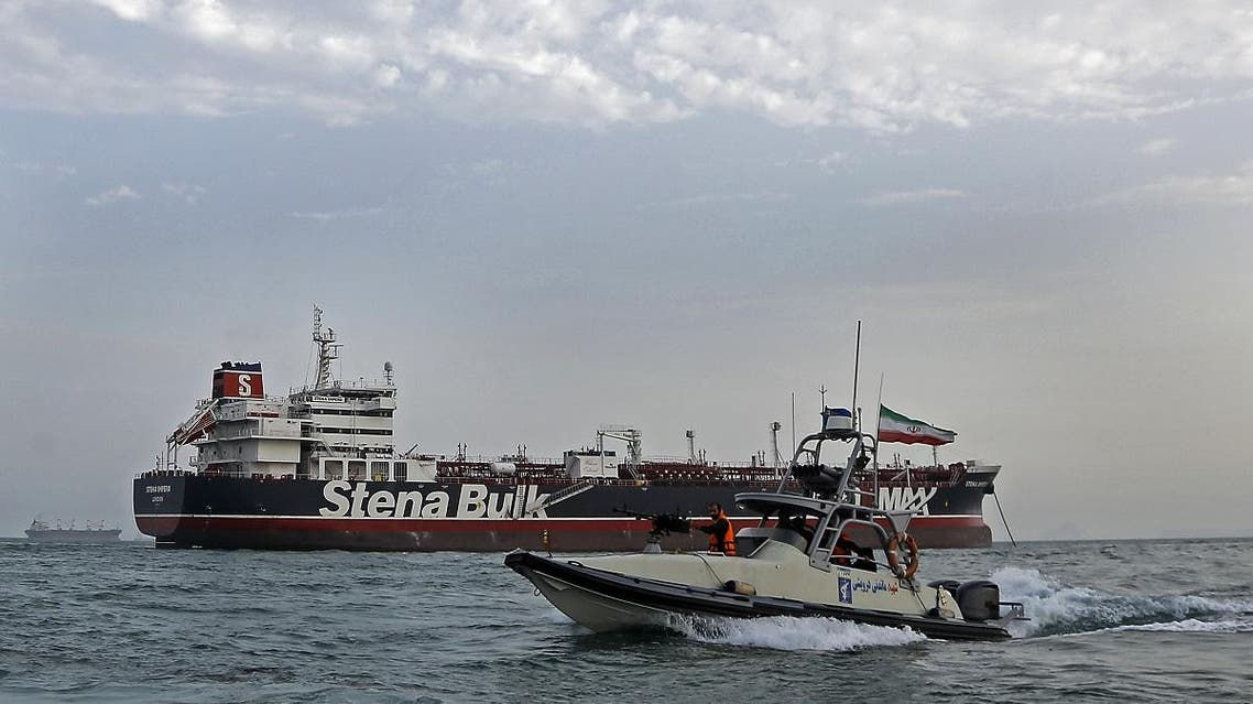 A picture taken on July 21, 2019, shows Iranian Revolutionary Guards patrolling around the British-flagged tanker Stena Impero as it's anchored off the Iranian port city of Bandar Abbas. (AFP)