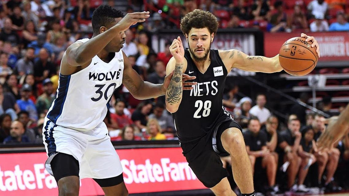Brooklyn Nets guard Isaia Cordinier (28) dribbles against Minnesota Timberwolves forward Kelan Martin (30) during the second half of an NBA Summer League game against the Minnesota Timberwolves. (Reuters)