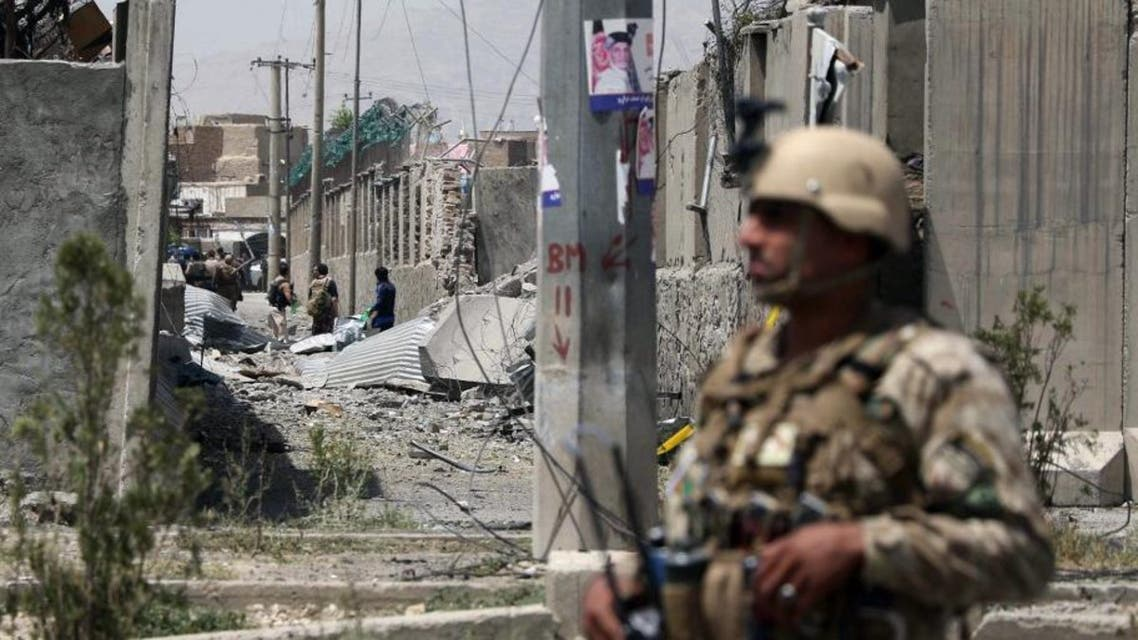 An Afghan security personnel stands guard at the site where a Taliban car bomb detonated at the entrance of a police station in Kabul on August 7, 2019. (AFP)