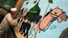 Egyptian artist paints murals on houses to celebrate Hajj