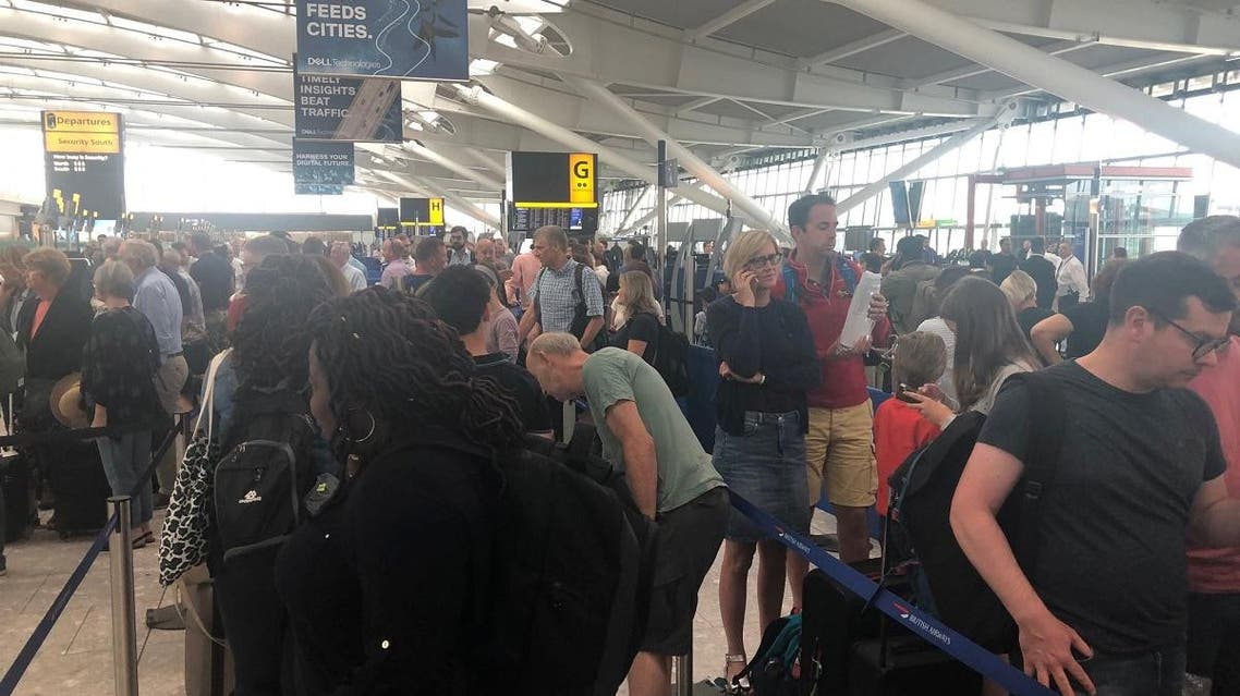 Passengers wait in long queues at Heathrow Airport as IT problems caused flight delays in London, Britain, on August 7, 2019, in this picture obtained from social media. (Reuters)