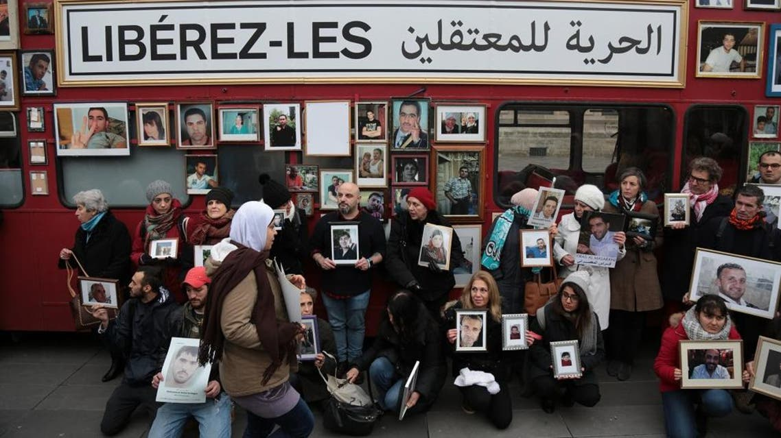 Activists hold portraits of those detained or missing to demand freedom for those detained in Syria. (File photo: AFP)