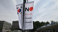Japan's move to lower South Korea trade status takes effect