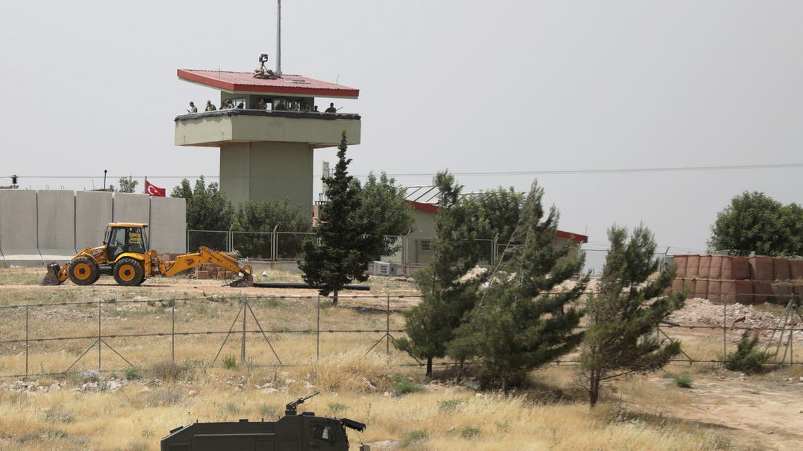 FILE PHOTO: Turkish soldiers stand on a watch tower at the Atmeh crossing on the Syrian-Turkish border, as seen from the Syrian side, in Idlib governorate, Syria May 31, 2019. REUTERS/Khalil Ashawi - RC1525F30880/File Photo