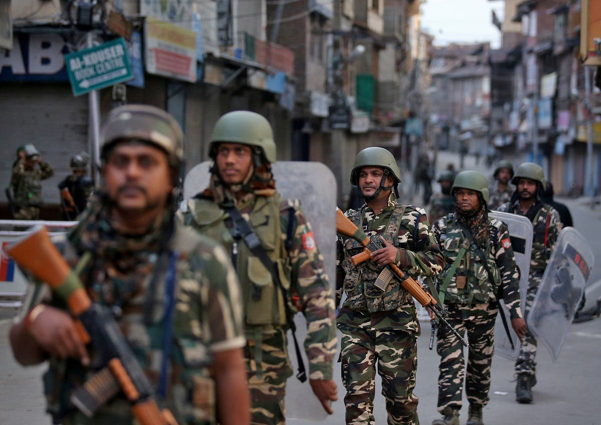 Indian security forces personnel patrol a deserted street during restrictions after the government scrapped special status for Kashmir, in Srinagar, on August 9, 2019. (Reuters)