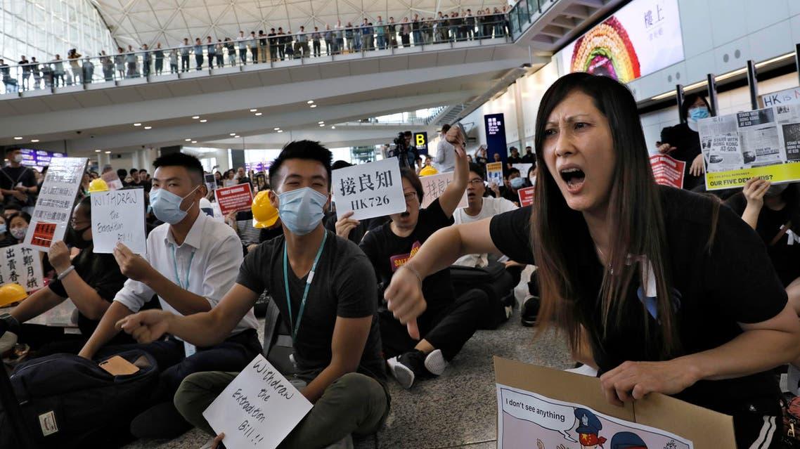 Demonstrators shout slogans during a protest at Hong Kong International Airport, Friday, July 26, 2019 (AP)
