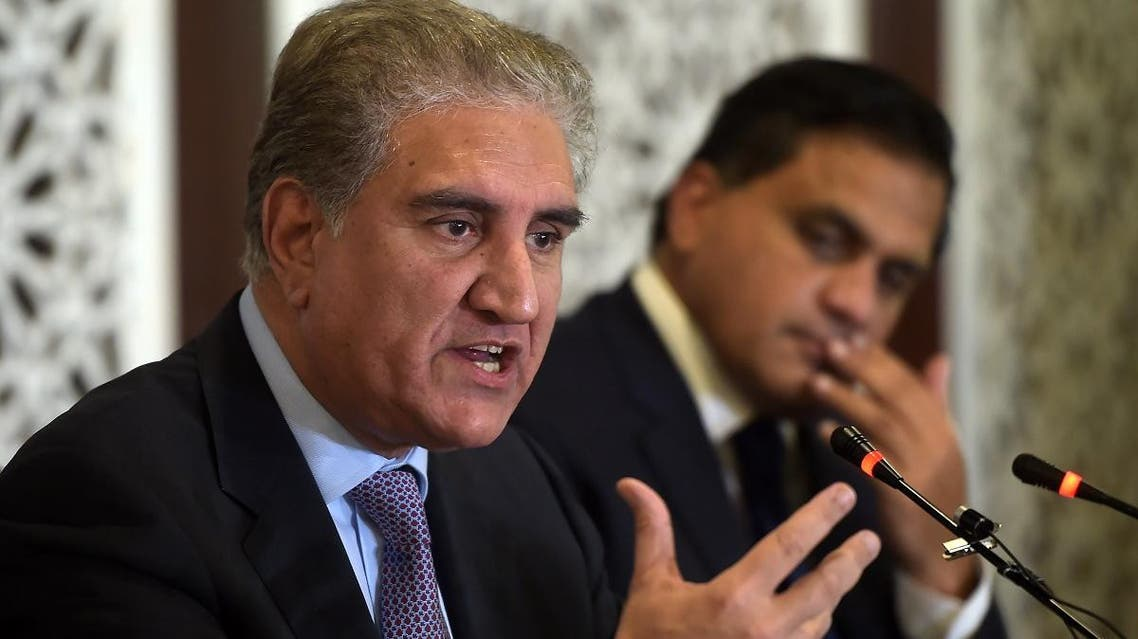 Pakistani Foreign Minister Shah Mehmood Qureshi (L) speaks during a press conference at the Foreign Ministry in Islamabad on August 8, 2019.  (AFP)