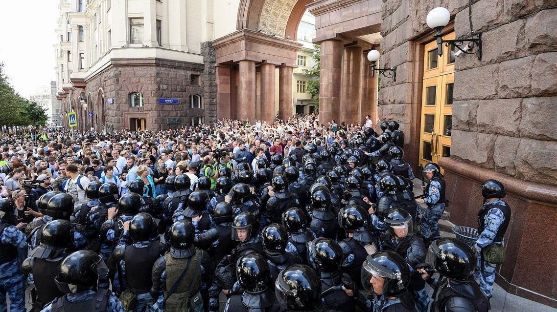 Protesters confront riot police during an unauthorised rally demanding independent and opposition candidates be allowed to run for office in local election in September, in downtown Moscow on July 27, 2019. (AFP)
