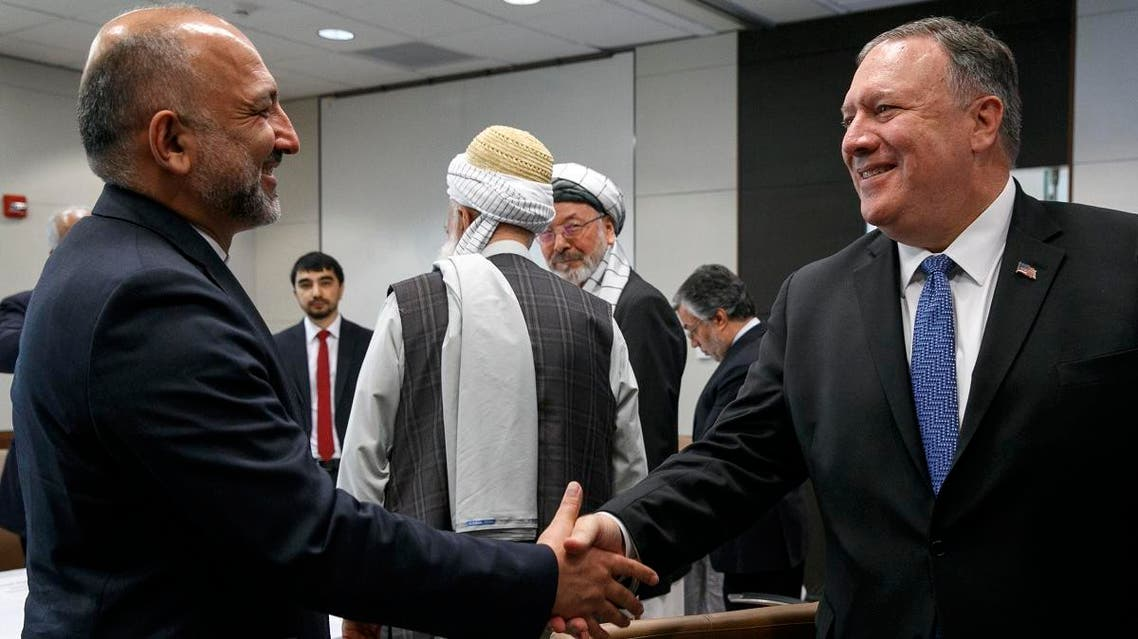 Secretary of State Mike Pompeo shakes hands with Hanif Atmar, Afghan Presidential Candidate and former National Security Adviser, during a meeting with Afghan politicians, on June 25, 2019, in Kabul, Afghanistan. (AFP)