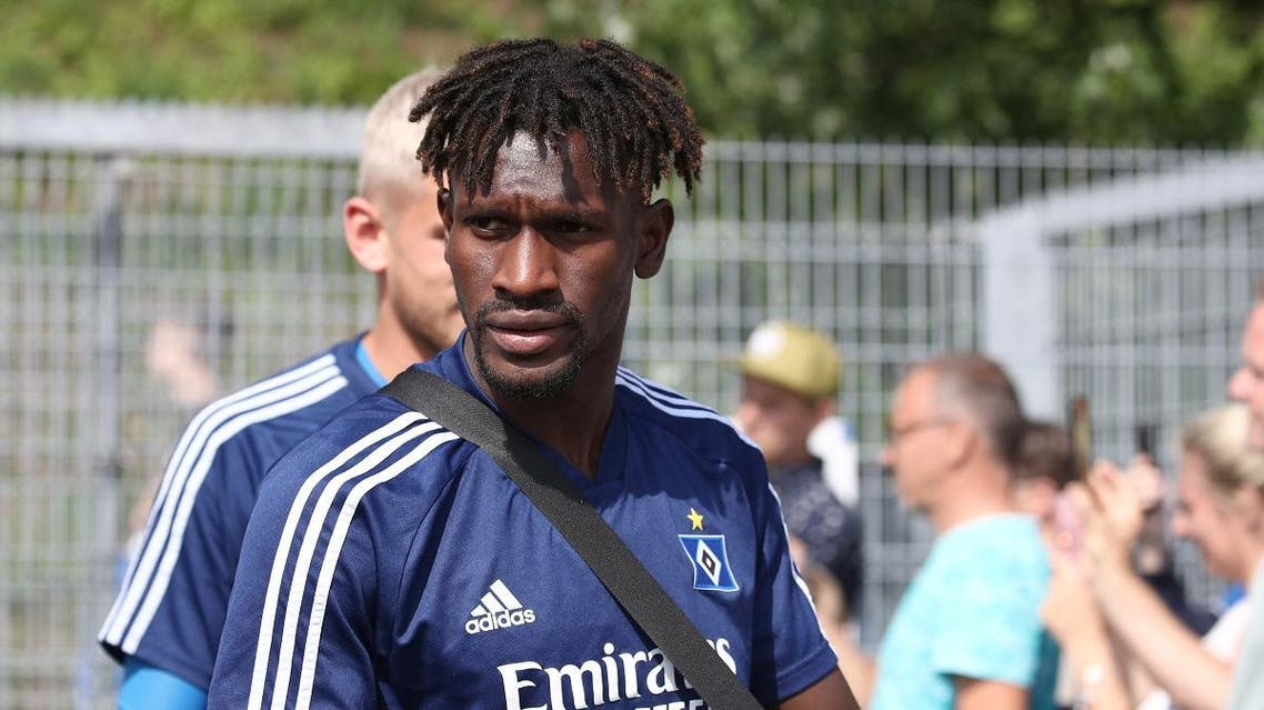 Hamburg's Gambian forward Bakery Jatta and his teammates arrive for a training session in Hamburg, northern Germany on August 8, 2019. (AFP)