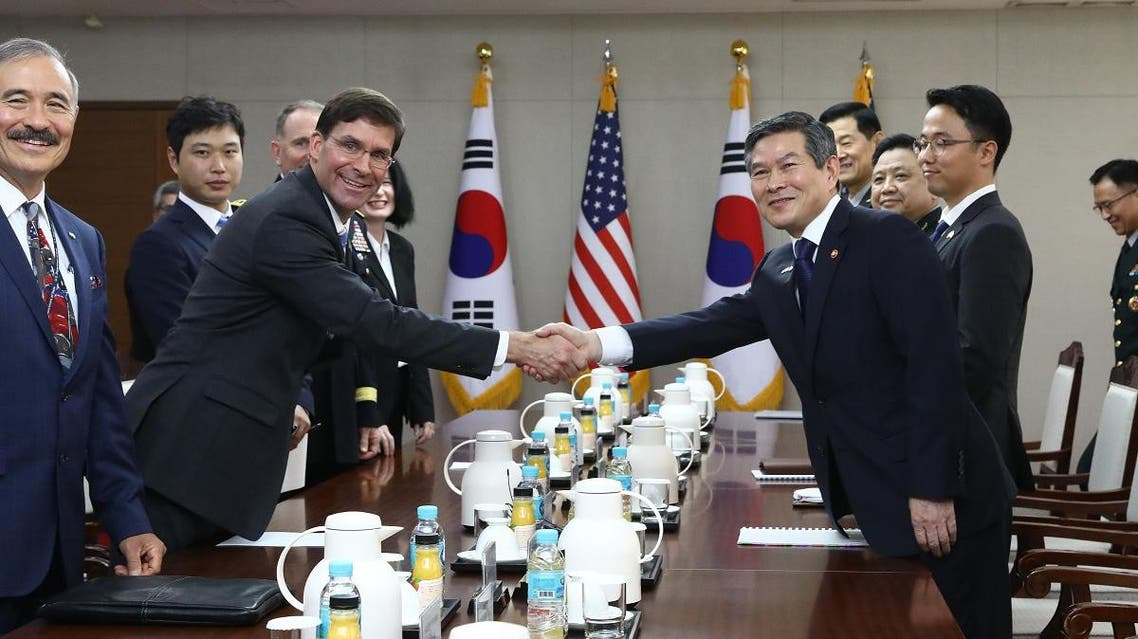 US Secretary of Defense Mark Esper (centre L) shakes hands with South Korea's Defense Minister Jeong Kyeong-doo (centre R) during their meeting at the Defense Ministry in Seoul on August 9, 2019. (AFP)