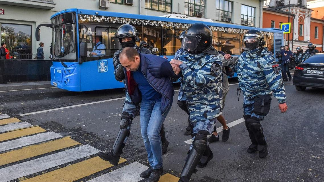 Servicemen of the Russian special police forces detain a man after a rally urging fair elections in central Moscow on August 10, 2019. (AFP)