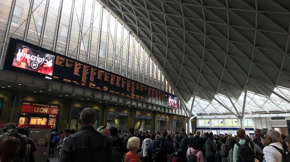People wait for trains at King's Cross station in London Saturday, Aug. 10, 2019 a day after all services in and out of the station were suspended when a power cut caused major disruption across the country. (AP)