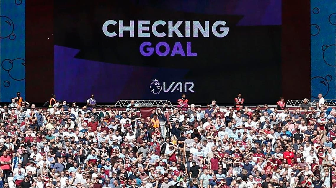 The big screen informs the crowd that the VAR (video assistant referee) is checking Manchester City's third goal, which is ruled as a valid goal. (AFP)