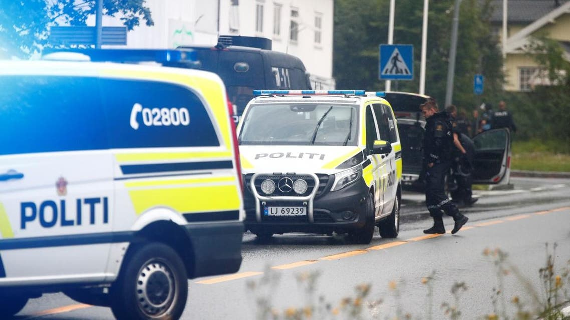 A picture taken on August 10, 2019 shows police vehicles near the al-Noor islamic center mosque where a gunman, armed with multiple weapons, went on a shooting spree in the town of Baerum, an Oslo suburb. (AFP)