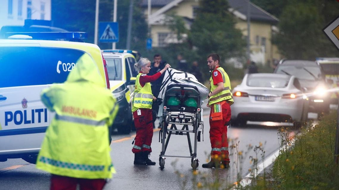 Medics with a stretcher near the al-Noor islamic center mosque where a gunman, armed with multiple weapons, went on a shooting spree in the town of Baerum, an Oslo suburb. (AFP)