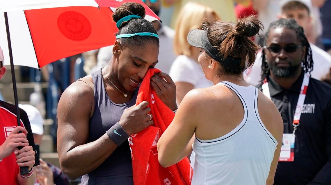 Serena Williams (left) dries her eyes with a towel after withdrawing in the championship match against Bianca Andreescu (right) during the Rogers Cup tennis tournament at Aviva Centre in Toronto, Canada on August 11, 2019. (Reuters)