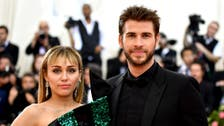 Cyrus and Hemsworth split after less than year of marriage
