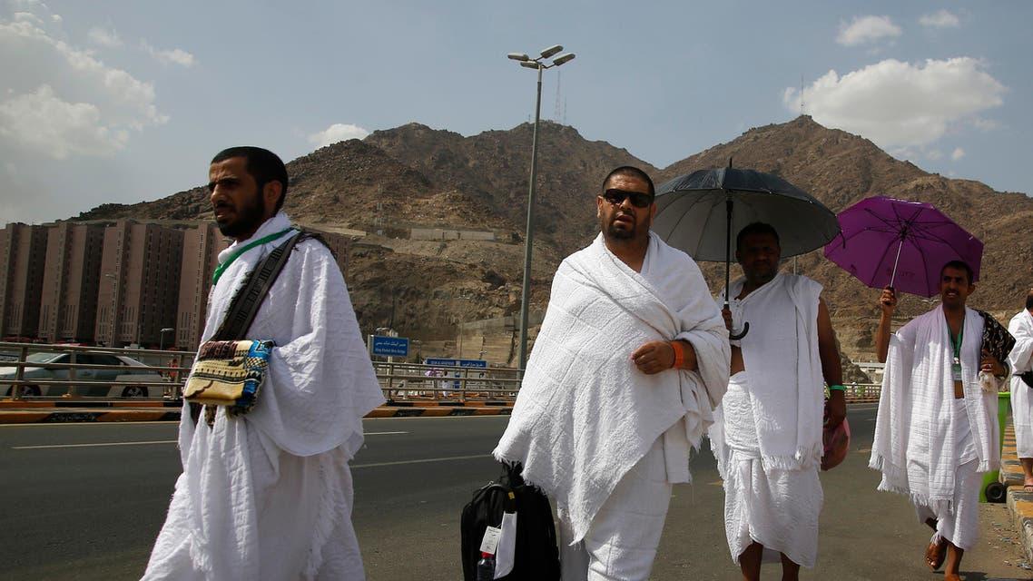 Yemeni Pilgrims walk Friday, Aug. 9, 2019, at the huge tent city of Mina, in Mecca, Saudi Arabia, where pilgrims will spend the night before heading to Arafat Saturday for the main day of the annual Hajj pilgrimage. (AP)