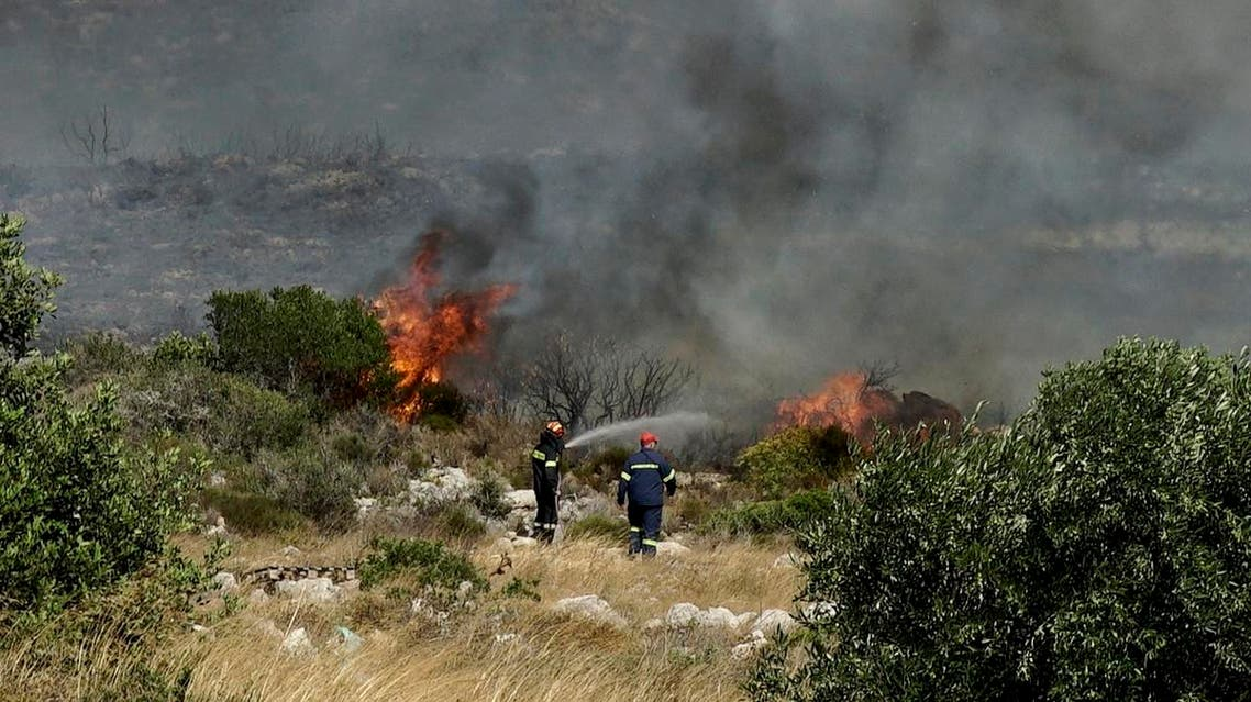 Firefighters extinguish a wildfire at Elafonisos island, south of Peloponnese peninsula, on Saturday, Aug. 10, 2019. (AP)