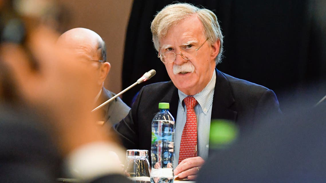 Handout photo released by the Peruvian Ministry of Foreign Affairs of US President Donald Trump's National Security Advisor, John Bolton, speaking during the International Conference for Democracy in Venezuela in Lima on August 6, 2019. Washington warned third parties on Tuesday to avoid doing business with the Venezuelan regime of Nicolas Maduro, as delegates from some 60 countries met in Lima to discuss ways of ending the crisis in South American nation.