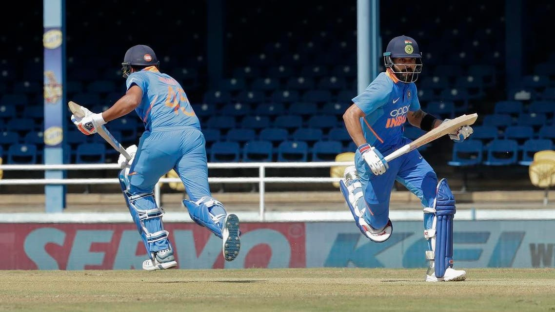 India captain Virat Kohli (right), and Rohit Sharma, run between the wickets during their second One-Day International cricket match against West Indies in Port of Spain, Trinidad, on August 11, 2019. (AP)