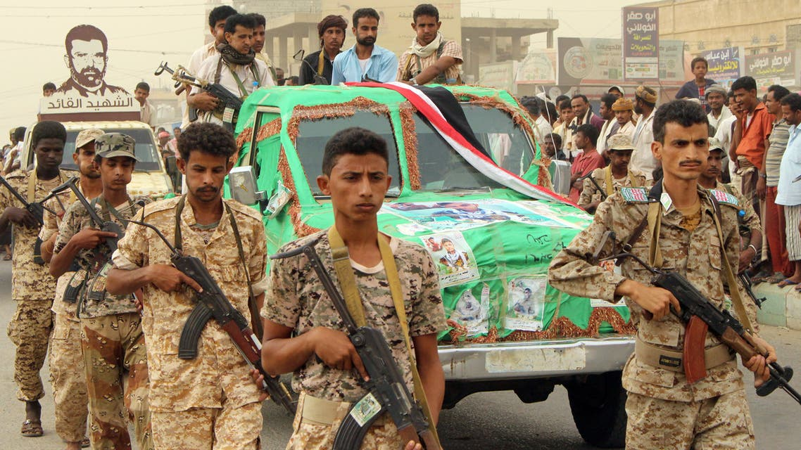 Yemeni soldiers, supporters of the Huthis, march during the funeral of a Military leader killed in the province of Hodeida, northern district of Abs, Hajjah governorate, on July 18, 2018.