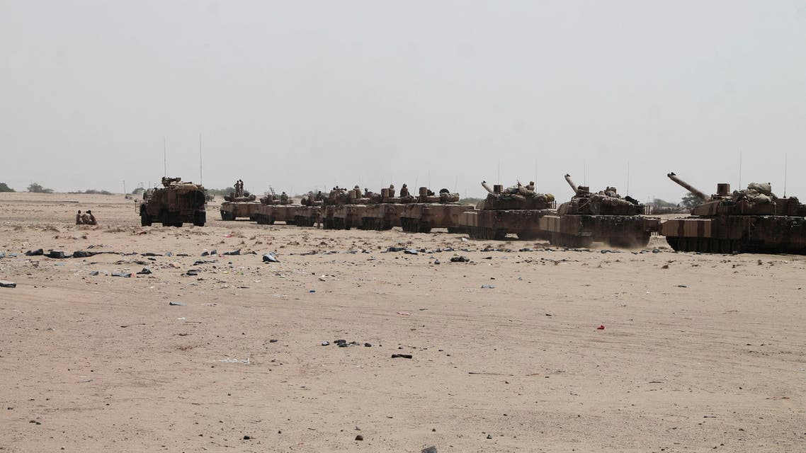 In this photo taken on Monday, Aug. 3, 2015, tanks and armored vehicles belonging to fighters against Shiite rebels known as Houthis gather on a road leading to Al-Anad base near Aden in the southern province of Lahej, Yemen. Pro-government troops seized the base from Shiite rebels on Monday, military officials said. The capture of Al-Anad was a significant victory for the forces allied to Yemen's exiled President Abed Rabbo Mansour Hadi in their battle to reverse the gains of Houthis. (AP Photo/Wael Qubady)