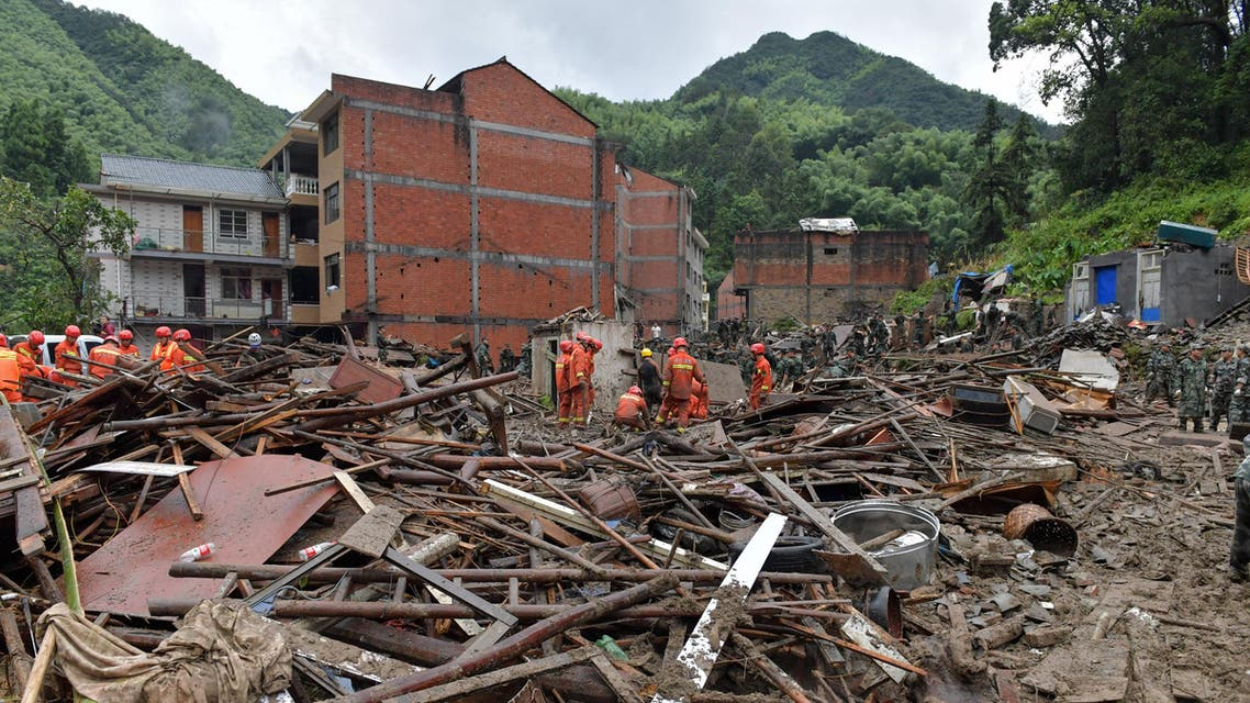 Rescuers look for survivors in the rubble of damaged buildings after a landslide caused by torrential rain from Typhoon Lekima, at Yongjia, in Wenzhou, in China's eastern Zhejiang province on August 10, 2019. (AFP)