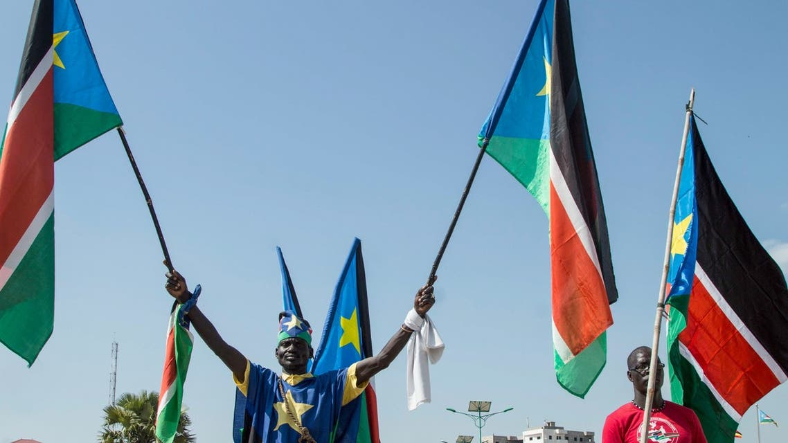 People wave the national flags of South Sudan during a peace ceremony in Juba, South Sudan, on October 31, 2018. South Sudan rebel leader Riek Machar returned to the capital Juba for the first time in more than two years on October 31, 2018, saying he arrived with a message of peace.