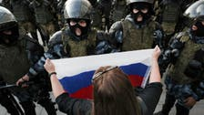 Russian police probe video of officer beating woman