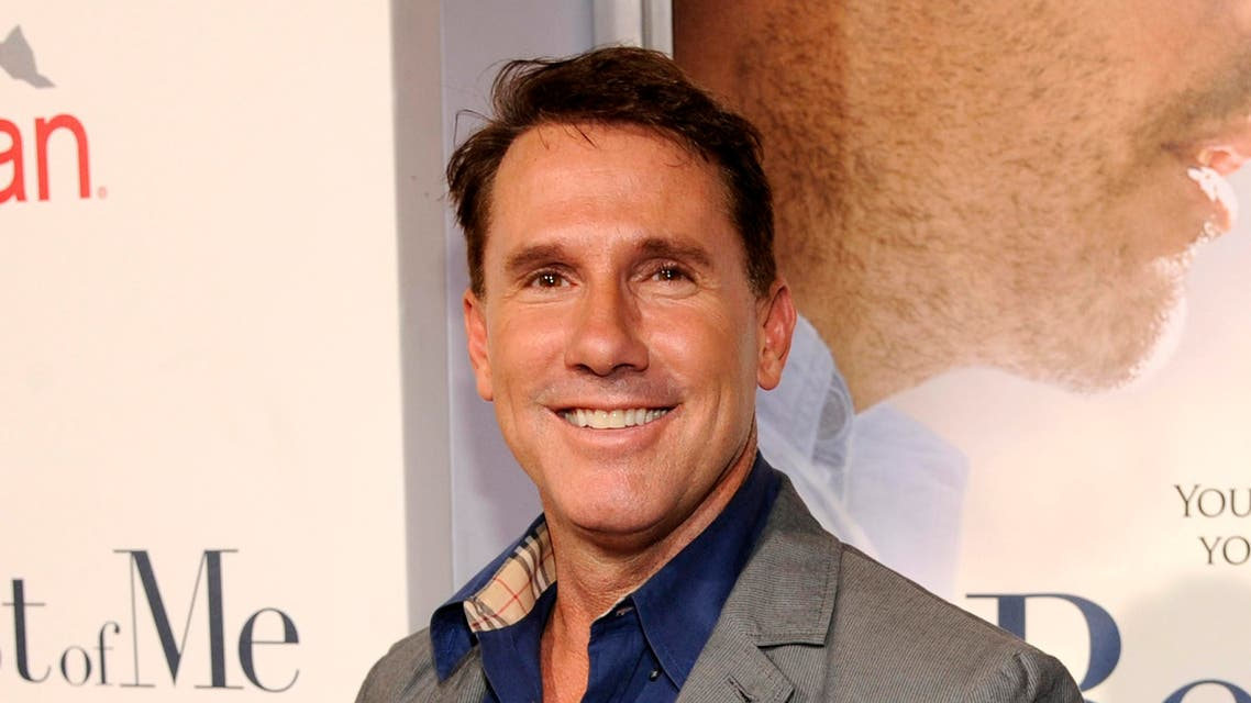 """In this Oct. 7, 2014 file photo, Nicholas Sparks poses at the premiere of the film """"The Best of Me"""" at Regal Cinemas L.A.  (AP)"""