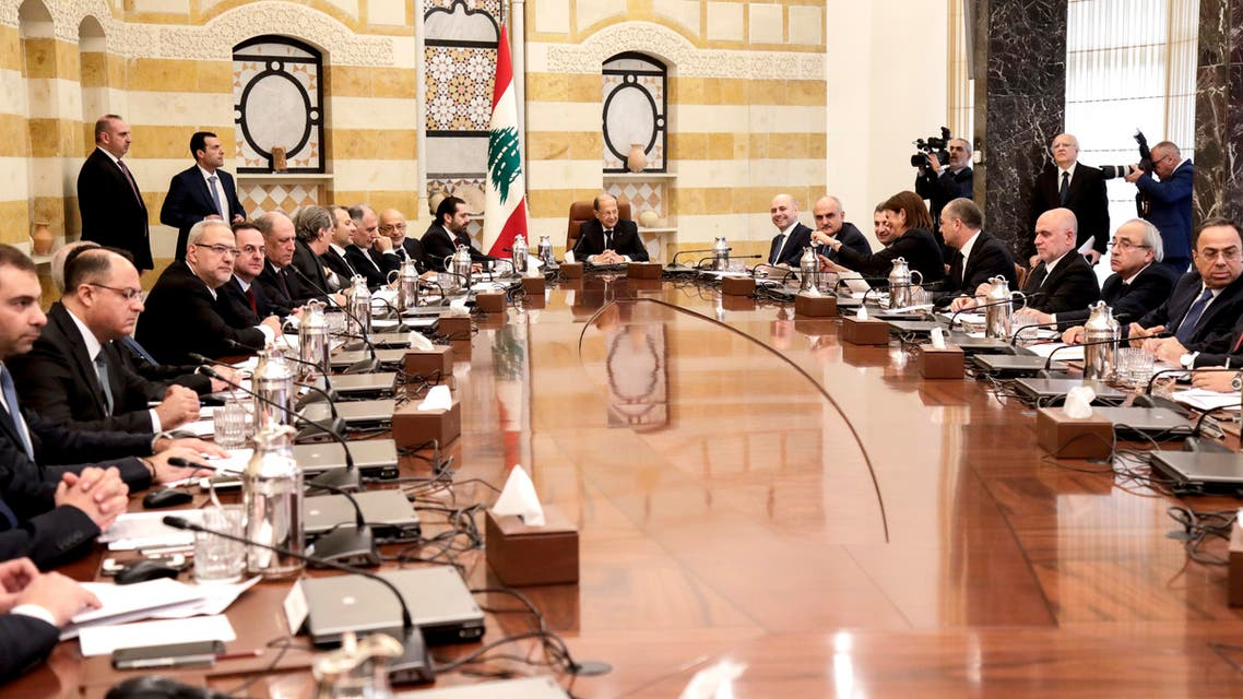 Lebanese President Michel Aoun (C) chairs the new government's first cabinet meeting, accompanied by Prime Minister Saad Hariri (C-L), at the presidential palace in Baabda, east of the capital Beirut on February 2, 2019. Lebanon announced a government line-up on January 31, ending an eight-month wait that had heightened fears of a major economic collapse. The new cabinet, unveiled during a press conference at the presidential palace, includes 30 ministers from Lebanon's rival political clans. The new line-up is to see four women take up office, including the interior and energy ministries.