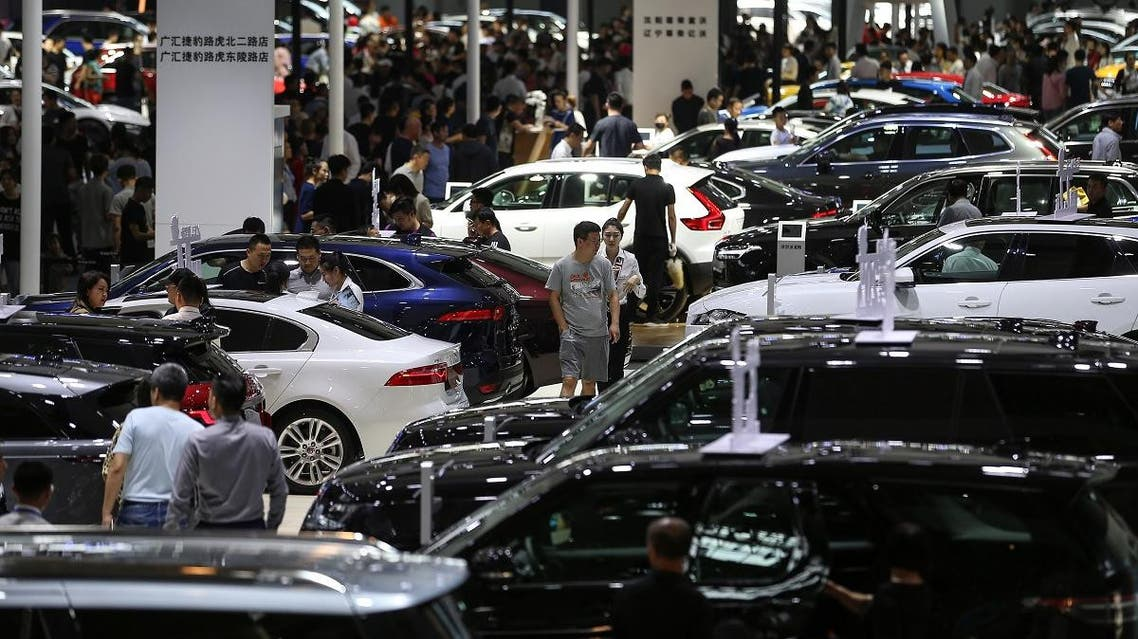 People visiting the 18th Shenyang, International Automobile Industry Expo in Shenyang, in China's northeastern Liaoning province. (AFP)