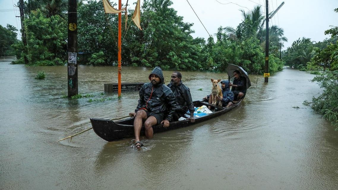 Residents are being evacuated from their home to a safer place following floods warnings, on a wooden boat in Kochi in the Indian state of Kerala on August 10, 2019. (AFP)