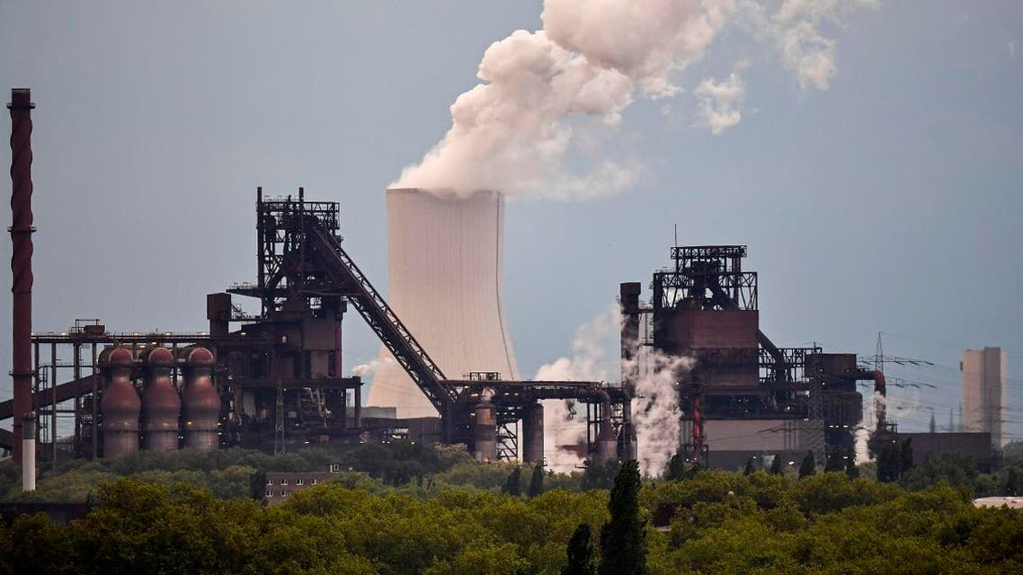 A power plant steams behind steel works of German steelmaker Thyssenkrupp in Duisburg, Germany, on May 9, 2019. (AP)