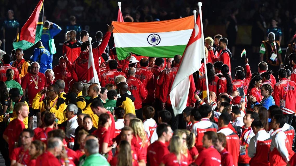 India's flag is seen among athletes during the closing ceremony of the 2018 Gold Coast Commonwealth Games at the Carrara Stadium on the Gold Coast on April 15, 2018. (AFP)