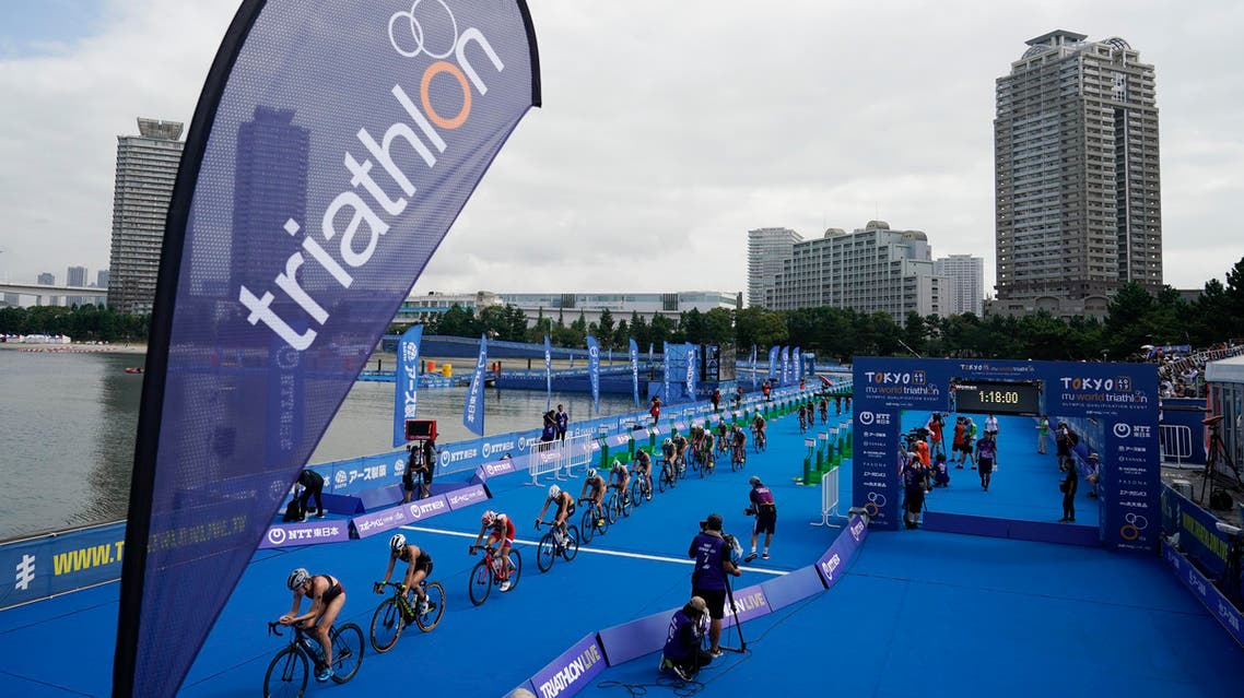 Athletes compete during a women's triathlon test event at Odaiba Marine Park, a venue for marathon swimming and triathlon at the Tokyo 2020 Olympics, Thursday, Aug. 15, 2019, in Tokyo. (AP)