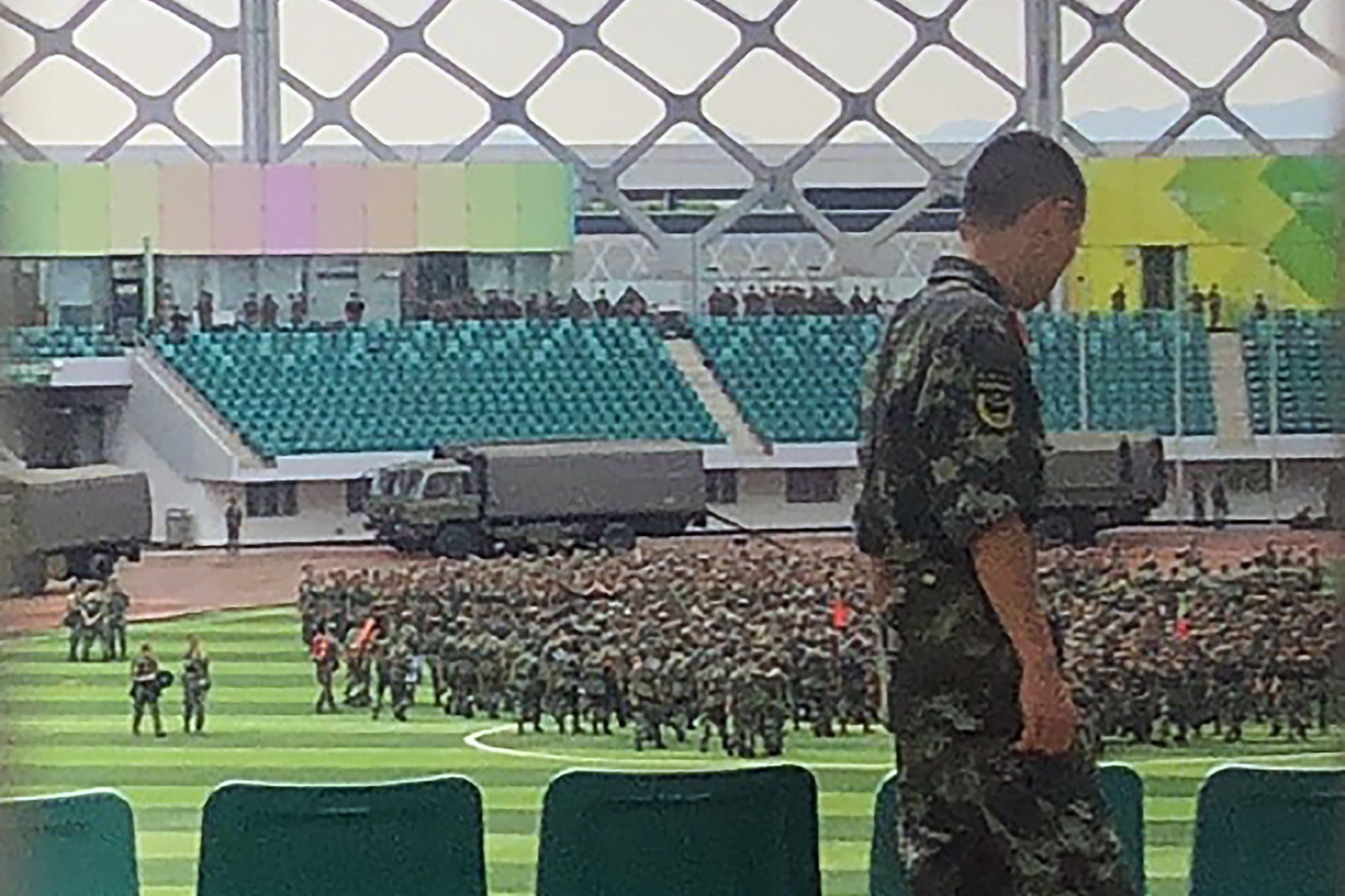 Chinese military personnel gather at the Shenzhen Bay stadium in Shenzhen, bordering Hong Kong in China's southern Guangdong province, on August 15, 2019. (AFP)