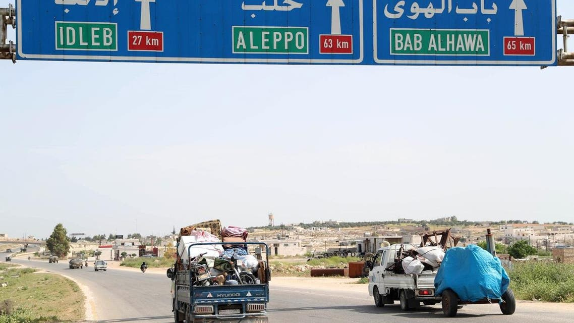 A picture taken on May 6, 2019 shows a truck loaded with belongings of a family as they flee from reported regime shelling on the southern countryside of the rebel-held Idlib province. (AFP)